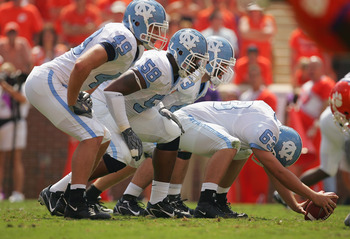 CLEMSON, SC - SEPTEMBER 23:  (L-R) Ryan Taylor #49, Melik Brown #58, Patrick Marsh #63 and Nick Starcevic #43 of the University of North Carolina Tar Heels line up at the line of scrimmage against the Clemson Tigers during their game on September 23, 2006