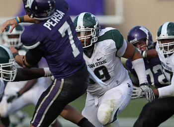 EVANSTON, IL - OCTOBER 23: Jerel Worthy #99 of the Michigan State Spartans rushes towards Dan Persa #7 of the Northwestern Wildcats at Ryan Field on October 23, 2010 in Evanston, Illinois. Michigan State defeated Northwestern 35-27. (Photo by Jonathan Dan