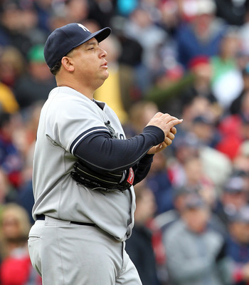 BOSTON, MA - APRIL 8:  Bartolo Colon #40 of the New York Yankees reacts against the Boston Red Sox on Opening Day at Fenway Park on April 8, 2011 in Boston, Massachusetts. (Photo by Jim Rogash/Getty Images)
