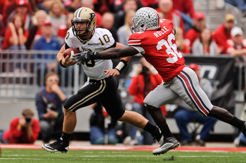 COLUMBUS, OH - OCTOBER 23:  Brian Rolle #36 of the Ohio State Buckeyes attempts to tackle Sean Robinson #10 of the Purdue Boilermakers at Ohio Stadium on October 23, 2010 in Columbus, Ohio.  (Photo by Jamie Sabau/Getty Images)