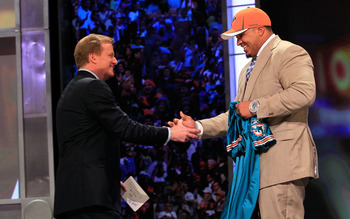 NEW YORK, NY - APRIL 28:  NFL Commissioner Roger Goodell (L) greets Mike Pouncey, #15 overall pick by the Miami Dolphins, on stage during the 2011 NFL Draft at Radio City Music Hall on April 28, 2011 in New York City.  (Photo by Chris Trotman/Getty Images