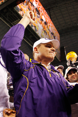 ARLINGTON, TX - JANUARY 07:  Head coach Les Miles of the Louisiana State University Tigers celebrates after defeating the Texas A&M Aggies 41-24 during the AT&T Cotton Bowl at Cowboys Stadium on January 7, 2011 in Arlington, Texas.  (Photo by Chris Grayth