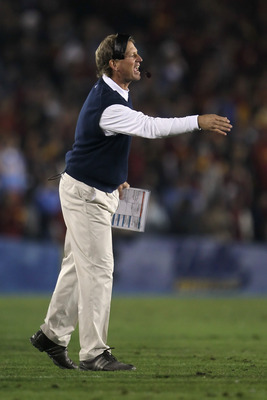 PASADENA, CA - DECEMBER 04:  UCLA Bruins head coach Rick Neuheisel yells from the sideline against the USC Trojans at the Rose Bowl on December 4, 2010 in Pasadena, California.  USC defeated UCLA 28-14. (Photo by Jeff Gross/Getty Images)