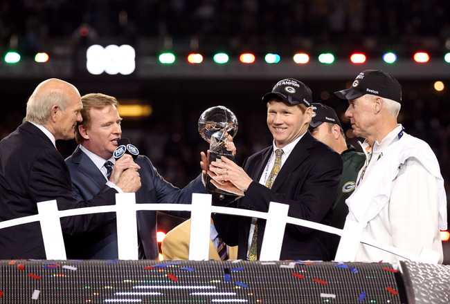 ARLINGTON, TX - FEBRUARY 06:  President and CEO of the Green Bay Packers Mark Murphy holds up the Vince Lombardi Trophy after winning Super Bowl XLV against the Pittsburgh Steelers 31-25 as Green Bay Packers General Manager Ted Thompson and NFL Commission
