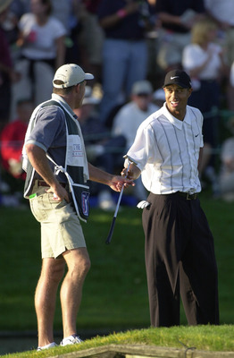 24 March 2001:  Tiger Woods laughs with caddie Steve Williams after making birdie on the 17th hole at the TPC at Sawgrass during the third round of play at The Players Championship in Ponte Vedra Beach, Florida.  DIGITAL IMAGE.  Mandatory Credit: Harry Ho