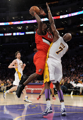 LOS ANGELES, CA - MARCH 20:  Gerald Wallace #3 of the Portland Trail Blazers attempts a shot in front of Lamar Odom #7 of the Los Angeles Lakers at the Staples Center on March 20, 2011 in Los Angeles, California.  NOTE TO USER: User expressly acknowledges