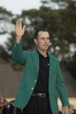 AUGUSTA, GA - APRIL 13:  Mike Weir of Canada wears the green jacket after winning the play off after the final round of the 2003 Masters Tournament at the Augusta National Golf Club in Augusta, Georgia on April 13, 2003. (Photo by Andrew Redington/Getty I