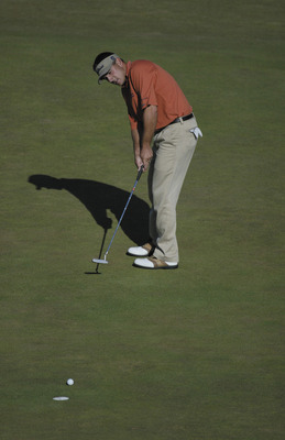 SANDWICH, ENGLAND - JULY 20:  Ben Curtis of the USA putts on the 18th green to finish one under during the final round of the Open Championship at the Royal St. George's course on July 20, 2003 in Sandwich, England. (Photo by Ross Kinnaird/Getty Images)