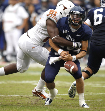 HOUSTON - SEPTEMBER 04:  Quarterback Taylor McHargue #16 of the Rice Owls loses the ball after he is sacked by defensive end Sam Acho #81 of the Texas Longhorns at Reliant Stadium on September 4, 2010 in Houston, Texas. Texas recovered the fumble and scor