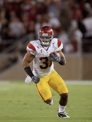 PALO ALTO, CA - OCTOBER 09:  Stanley Havili #31 of the USC Trojans runs with the ball during their game against the Stanford Cardinal at Stanford Stadium on October 9, 2010 in Palo Alto, California.  (Photo by Ezra Shaw/Getty Images)