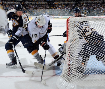 NASHVILLE, TN - APRIL 20:  Corey Perry #10 of the Anaheim Ducks fights Ryan Suter #20 of the Nashville Predators for a rebound in front of Predators goalie Pekka Rinne #35 in Game Four of the Western Conference Quarterfinals during the 2011 NHL Stanley Cu
