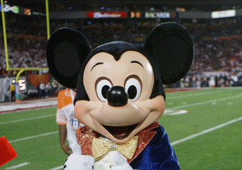 MIAMI - JANUARY 4:  Mickey Mouse is on the sidelines as the USC Trojans face the Oklahoma Sooners in the 2005 FedEx Orange Bowl National Championship on January 4, 2005 at Pro Player Stadium in Miami, Florida. USC defeated Oklahoma 55-19. (Photo by Doug P
