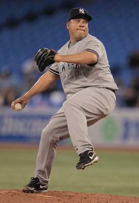 TORONTO, ON - APRIL 20:  Bartolo Colon #40 of the New York Yankees throws a pitch during their game against the Toronto Blue Jays at Rogers Centre on April 20, 2011 in Toronto, Canada.  (Photo by Scott Halleran/Getty Images)