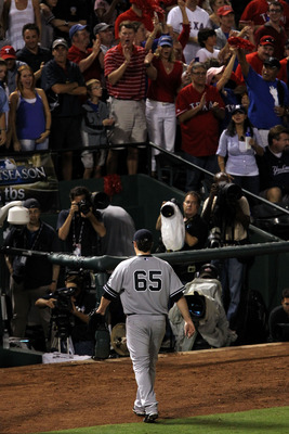 ARLINGTON, TX - OCTOBER 22:  Phil Hughes #65 of the New York Yankees walks off the field after being pulled in the fifth inning of Game Six of the ALCS against the Texas Rangers during the 2010 MLB Playoffs at Rangers Ballpark in Arlington on October 22,