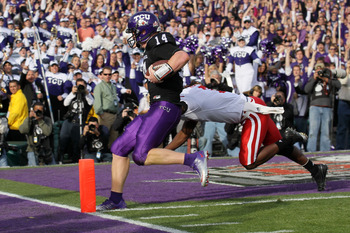 PASADENA, CA - JANUARY 01:  Quarterback Andy Dalton #14 of the TCU Horned Frogs scores a touchdown against the Wisconsin Badgers in the first quarter of the 97th Rose Bowl game on January 1, 2011 in Pasadena, California.  (Photo by Stephen Dunn/Getty Imag