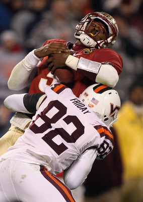 CHARLOTTE, NC - DECEMBER 04:  EJ Manuel #3 of the Florida State Seminoles is sacked by Steven Friday #82 of the Virginia Tech Hokies during their game at Bank of America Stadium on December 4, 2010 in Charlotte, North Carolina.  (Photo by Streeter Lecka/G