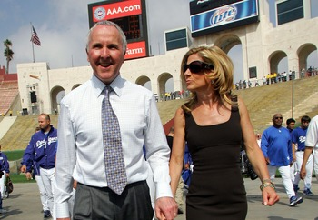 LOS ANGELES, CA - MARCH 29:  Los Angeles Dodgers owner Frank McCourt (L) and his wife Jamie walk into the Memorial Coliseum prior to the start of the game against the Boston Red Sox March 29, 2008 in Los Angeles, California.  (Photo by Jeff Gross/Getty Im