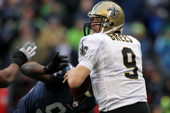 SEATTLE, WA - JANUARY 08:  Quarterback Drew Brees #9 of the New Orleans Saints scrambles against the Seattle Seahawks during the 2011 NFC wild-card playoff game at Qwest Field on January 8, 2011 in Seattle, Washington.  (Photo by Jonathan Ferrey/Getty Ima