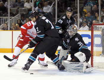 SAN JOSE, CA - APRIL 29:  Niclas Wallin #7 and Antti Niemi #31 of the San Jose Sharks stop the puck during their game against the Detroit Red Wings in Game One of the Western Conference Semifinals during the 2011 NHL Stanley Cup Playoffs at HP Pavilion on