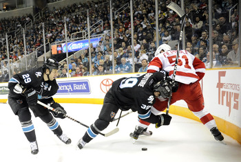 SAN JOSE, CA - MARCH 3: Ryane Clowe #29 and Logan Couture #39 of the San Jose Sharks looks to get the puck away from Valtteri Filppula #51 of the Detroit Red Wings in the second period of an NHL hockey game at the HP Pavilion on March 3, 2011 in San Jose,