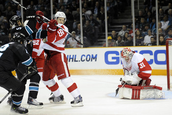 SAN JOSE, CA - MARCH 3: Joey MacDonald #31 of the Detroit Red Wings gets some help defending his goal from teammate Niklas Kronwall #55 against the San Jose Sharks in the second period of an NHL hockey game at the HP Pavilion on March 3, 2011 in San Jose,