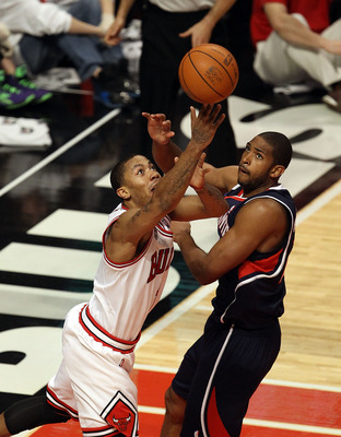 CHICAGO, IL - MARCH 11: Derrick Rose #1 of the Chicago Bulls puts up a shot against Al Horford #15 of the Atlanta Hawks on his way to a game-high 34 points at the United Center on March 11, 2011 in Chicago, Illinois. The Bulls defeated the Hawks 94-76. NO
