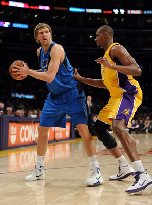 LOS ANGELES, CA - MARCH 31:  Dirk Nowitzki #41 of the Dallas Mavericks is guarded by Andrew Bynum #17 of the Los Angeles Lakers at Staples Center on March 31, 2011 in Los Angeles, California.  NOTE TO USER: User expressly acknowledges and agrees that, by
