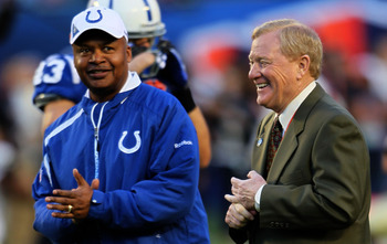 MIAMI GARDENS, FL - FEBRUARY 07:  Head Coach Jim Caldwell (L) of the Indianapolis Colts stands on the field during warm ups with President of the Indianapolis Colts Bill Polian prior to Super Bowl XLIV against the New Orleans Saints on February 7, 2010 at