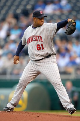 KANSAS CITY, MO - MAY 28:  Livan Hernandez #61 of the Minnesota Twins delivers a pitch against the Kansas City Royals on May 28, 2008 at Kauffman Stadium in Kansas City, Missouri. (Photo by G. Newman Lowrance/Getty Images)