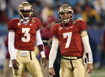 CHARLOTTE, NC - DECEMBER 04:   Teammates EJ Manuel #3 and Christian Ponder #7 of the Florida State Seminoles watch on during warmups before the start of their game against the Virginia Tech Hokies at Bank of America Stadium on December 4, 2010 in Charlott