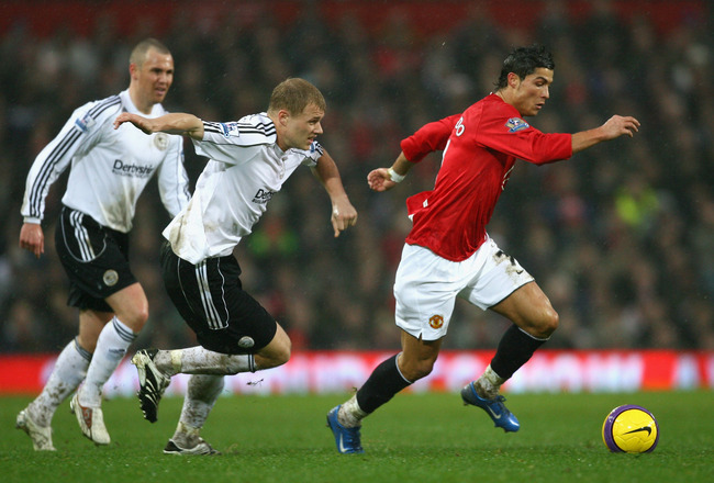 MANCHESTER, UNITED KINGDOM - DECEMBER 08:  Cristiano Ronaldo of Manchester United surges away from James McEveley of Derby County during the Barclays Premier League match between Manchester United and Derby County at Old Trafford on December 8, 2007 in Ma