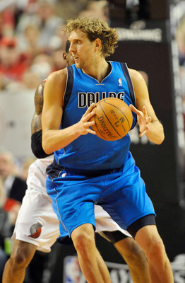 PORTLAND, OR - APRIL 28: Dirk Nowitski #41 of the Dallas Mavericks makes a move on LaMarcus Aldridge #12 of the Portland Trail Blazers closes in during the fourth quarter of Game Six of the Western Conference Quartefinals in the 2011 NBA Playsoffs on Apri