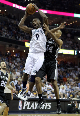 MEMPHIS, TN - APRIL 29:  Tony Allen #9 of the Memphis Grizzlies grabs a rebound while defended by Gary Neal #14 of the San Antonio Spurs during the Grizzlies 99-91 win over the Spurs  in Game Six of the Western Conference Quarterfinals in the 2011 NBA Pla