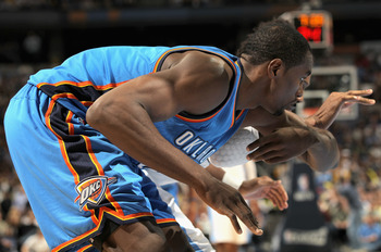 DENVER, CO - APRIL 25:  Serge Ibaka #9 of the Oklahoma City Thunder prepares to battle for rebounding position in Game Four of the Western Conference Quarterfinals in the 2011 NBA Playoffs on April 24, 2011 at the Pepsi Center in Denver, Colorado. NOTE TO