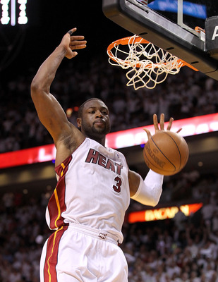 MIAMI, FL - APRIL 27: Dwyane Wade #3 of the Miami Heat dunks during game five of the Eastern Conference Quarterfinals in the 2011 NBA Playoffs against the Philadelphia 76ers at American Airlines Arena on April 27, 2011 in Miami, Florida. NOTE TO USER: Use
