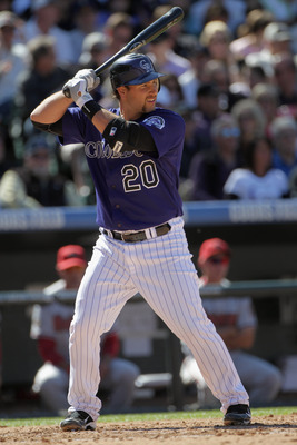 DENVER, CO - APRIL 01:  Chris Iannetta #20 of the Colorado Rockies takes an at bat against the Arizona Diamondbacks during Opening Day at Coors Field on April 1, 2011 in Denver, Colorado.  (Photo by Doug Pensinger/Getty Images)