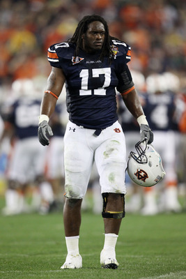 GLENDALE, AZ - JANUARY 10:  Josh Bynes #17 of the Auburn Tigers looks on against the Oregon Ducks during the Tostitos BCS National Championship Game at University of Phoenix Stadium on January 10, 2011 in Glendale, Arizona.  (Photo by Christian Petersen/G