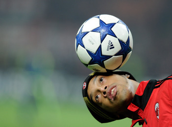 MILAN, ITALY - DECEMBER 08:  Ronaldinho of AC Milan before the UEFA Champions League Group G match between AC Milan and AFC Ajax at Stadio Giuseppe Meazza on December 8, 2010 in Milan, Italy.  (Photo by Claudio Villa/Getty Images)