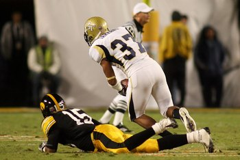 MIAMI GARDENS, FL - JANUARY 05:  Jerrard Tarrant #37 of the Georgia Tech Yellow Jackets recovers a fumble against the Iowa Hawkeyes during the FedEx Orange Bowl at Land Shark Stadium on January 5, 2010 in Miami Gardens, Florida.  (Photo by Marc Serota/Get