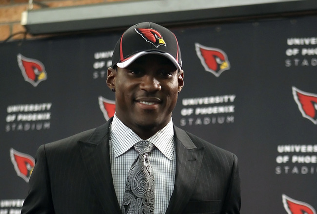 TEMPE, AZ - APRIL 29:  First round draft pick Patrick Peterson of the Arizona Cardinals poses with a team jersey during a press conference to introduce him at the team's training center auditorium on April 29, 2011 in Tempe, Arizona.  (Photo by Christian