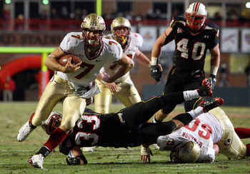 COLLEGE PARK, MD - NOVEMBER 22:  Christian Ponder #7 of the Florida State Seminoles runs the ball past Alex Wujciak #33 of the Maryland Terrapins on November 22, 2008 at Byrd Stadium in College Park, Maryland.  (Photo by Jim McIsaac/Getty Images)