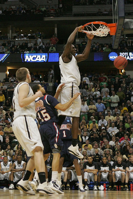 DENVER, CO - MARCH 17:  Festus Ezeli #3 of the Vanderbilt Commodores dunks the ball against Francis-Cedric Martel #15 of the Richmond Spiders during the second round of the 2011 NCAA men's basketball tournament at Pepsi Center on March 17, 2011 in Denver,