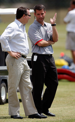 TAMPA - MAY 01:  General Manager Mark Dominik of the Tampa Bay Buccaneers talks with team owner Bryan Glazer during the Buccaneers Rookie Minicamp at One Buccaneer Place on May 1, 2009 in Tampa, Florida.  (Photo by J. Meric/Getty Images)