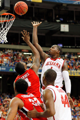 ATLANTA, GA - MARCH 11: JaMychal Green #1 of the Alabama Crimson Tide shoots over Chris Barnes #4 of the Georgia Bulldogs during the quarterfinals of the SEC Men's Basketball Tournament at Georgia Dome on March 11, 2011 in Atlanta, Georgia.  (Photo by Kev