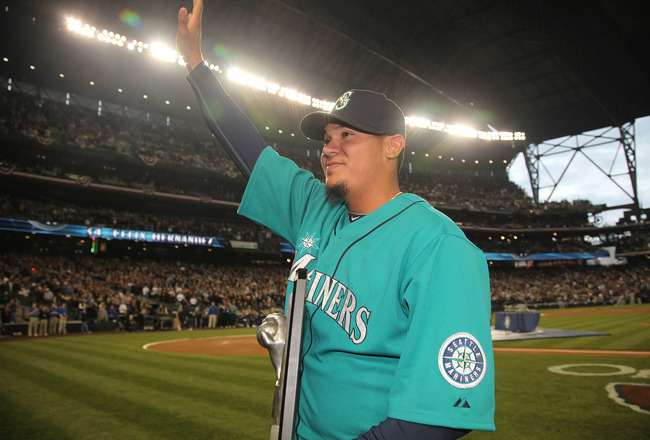 SEATTLE - APRIL 08:  Starting pitcher Felix Hernandez #34 of the Seattle Mariners waves to the crowd after receiving his American League Cy Young Award trophy prior to the Mariners' home opener against the Cleveland Indians at Safeco Field on April 8, 201