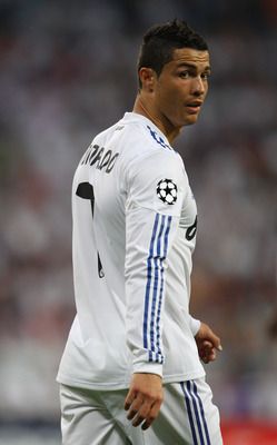MADRID, SPAIN - APRIL 27:  Cristiano Ronaldo of Real Madrid looks on during the UEFA Champions League Semi Final first leg match between Real Madrid and Barcelona at Estadio Santiago Bernabeu on April 27, 2011 in Madrid, Spain.  (Photo by Alex Livesey/Get