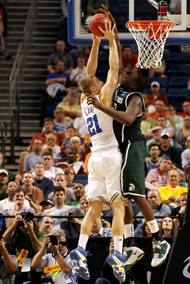 TAMPA, FL - MARCH 17:  Draymond Green #23 of the Michigan State Spartans blocks a shot attempt by Brendan Lane #21 of the UCLA Bruins in the second half during the second round of the 2011 NCAA men's basketball tournament at St. Pete Times Forum on March
