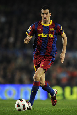 BARCELONA, SPAIN - FEBRUARY 05:  Sergio Busquets of Barcelona runs with the ball during the La Liga match between Barcelona and Atletico de Madrid at Camp Nou on February 5, 2011 in Barcelona, Spain. Barcelona won 3-0.  (Photo by David Ramos/Getty Images)