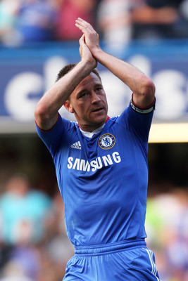 LONDON, ENGLAND - APRIL 30:  John Terry of Chelsea celebrate following their team's 2-1 victory during the Barclays Premier League match between Chelsea and Tottenham Hotspur at Stamford Bridge on April 30, 2011 in London, England.  (Photo by Scott Heavey