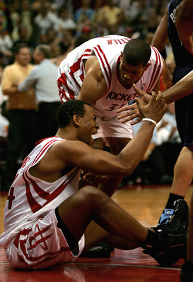 HOUSTON - APRIL 30:  Chuck Hayes #44 Shane Battier #31 of the Houston Rockets celebrate a foul against Hayes by the Utah Jazz in the closing seconds of the fourth period against during Game Five of the Western Conference Quarterfinals against the Utah Jaz